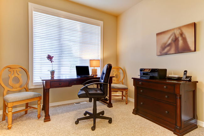 By placing your desk right in front of the window, and including some professional artwork with matching office furniture, converting an unused bedroom in the house can work perfectly for a home office.
