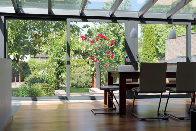If you're lucky enough to have a sunroom in your house, there is no better place to set up a home office.